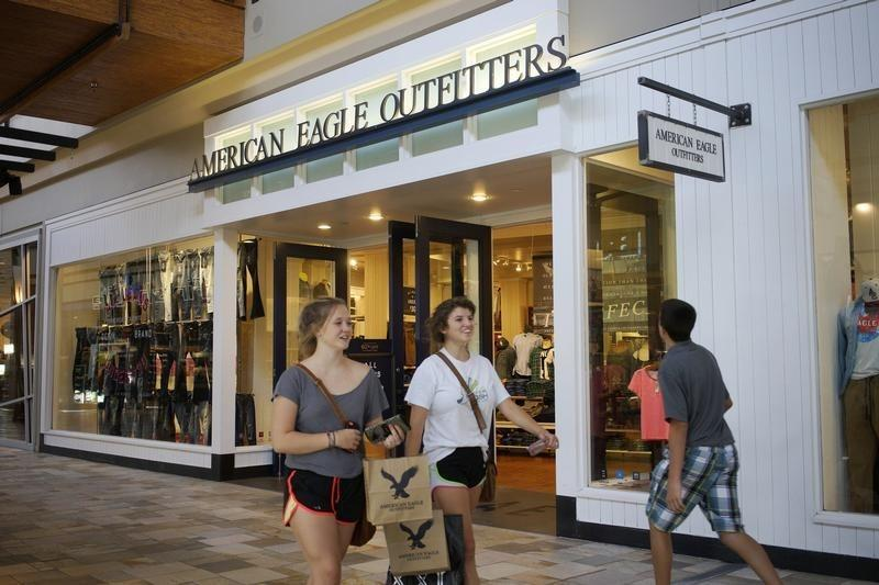 Shoppers leave the American Eagle Outfitters store in Broomfield