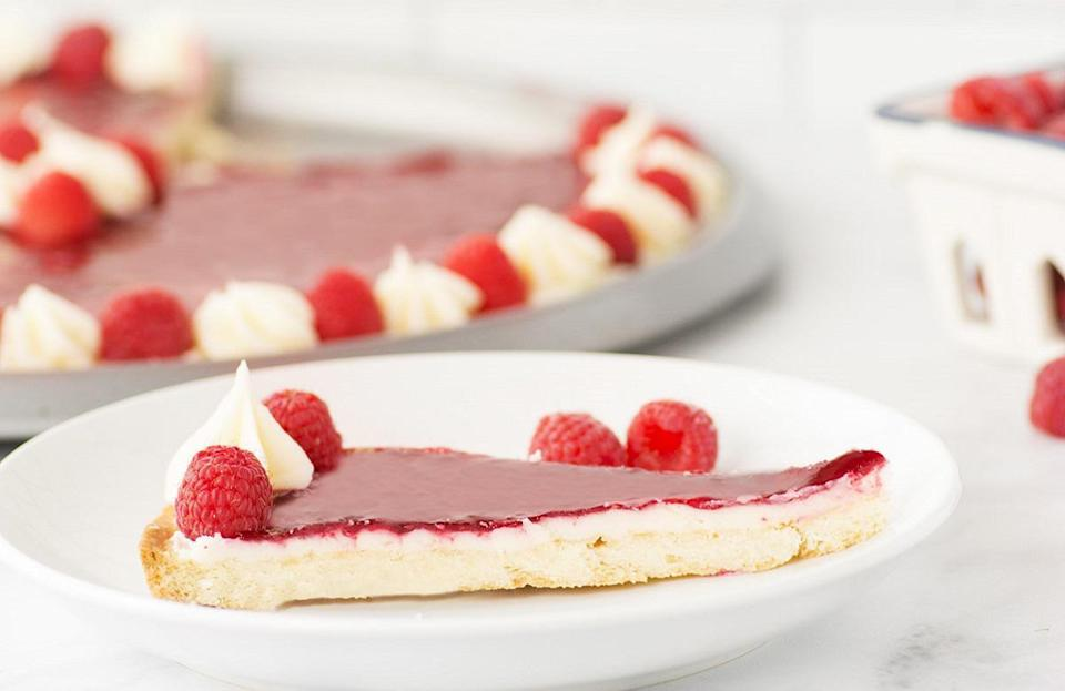 """<p>Red raspberry sauce and a cream cheese filling have this dessert leaning to the right side of our taste buds. This easy recipe simply requires fresh fruit and a few <a href=""""https://www.thedailymeal.com/cook/pantry-staple-recipes-easy?referrer=yahoo&category=beauty_food&include_utm=1&utm_medium=referral&utm_source=yahoo&utm_campaign=feed"""" rel=""""nofollow noopener"""" target=""""_blank"""" data-ylk=""""slk:pantry staples"""" class=""""link rapid-noclick-resp"""">pantry staples</a>.</p> <p><a href=""""https://www.thedailymeal.com/recipes/fresh-raspberry-tart-recipe-0?referrer=yahoo&category=beauty_food&include_utm=1&utm_medium=referral&utm_source=yahoo&utm_campaign=feed"""" rel=""""nofollow noopener"""" target=""""_blank"""" data-ylk=""""slk:For the Raspberry Tart recipe, click here."""" class=""""link rapid-noclick-resp"""">For the Raspberry Tart recipe, click here.</a></p>"""
