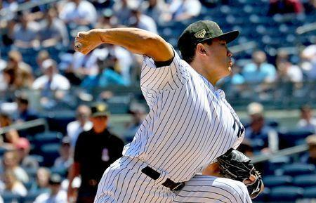 FILE PHOTO: May 18, 2019; Bronx, NY, USA; New York Yankees starting pitcher Masahiro Tanaka (19) delivers a pitch against the Tampa Bay Rays during the first inning at Yankee Stadium. Mandatory Credit: Andy Marlin-USA TODAY Sports