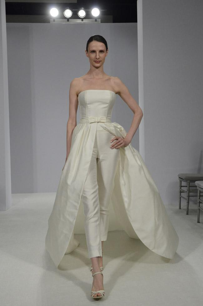"""<div class=""""caption-credit""""> Photo by: Nina Westervelt / The Knot</div><b>A Bridal Pantsuit</b> <br> A chic tailored pantsuit in the front and romantic ball gown in the back outfit by Rosa Clara is a modern take on the traditional wedding attire and perfect for the unconventional bride. <br>"""