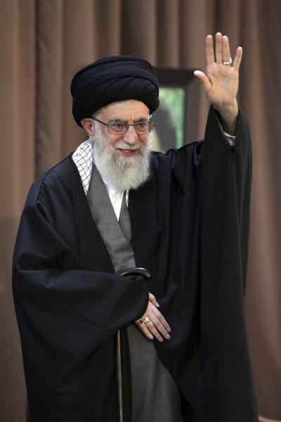 "In this picture released by an official website of the office of the Iranian supreme leader, Supreme Leader Ayatollah Ali Khamenei, waves to the audience before giving a speech at a public gathering in the city of Mashhad, Iran, Friday, March 21, 2014. Iran's top leader says his nation can best counter sanctions imposed by the West by strengthening its economy. Khamenei said Iranians should not wait for the sanctions to be lifted but work to build a stronger economy to ""reduce vulnerability."" (AP Photo/Office of the Iranian Supreme Leader)"
