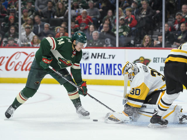 Pittsburgh Penguins goalie Matt Murray(30) blocks a shot by Minnesota Wild center Joel Eriksson Ek (14) during the second period of an NHL hockey game Saturday, Oct. 12, 2019, in St. Paul, Minn. (AP Photo/Craig Lassig)