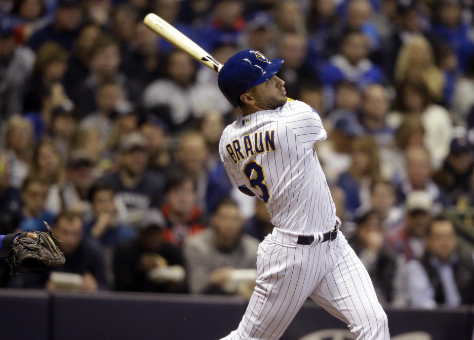Milwaukee Brewers' Ryan Braun watches his two-run home run against the Chicago Cubs during the second inning of a baseball game Friday, April 5, 2019, in Milwaukee. (AP Photo/Jeffrey Phelps)