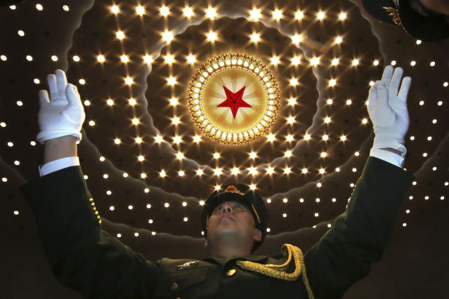 <p>A Chinese military band conductor leads the band at the end of the opening session of the annual National People's Congress in Beijing's Great Hall of the People on March 5, 2018. (Photo: Ng Han Guan/AP) </p>