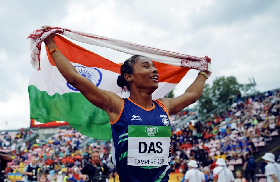 Athletics - 2018 IAAF World U20 Championships – women's 400 metres – Tampere, Finland – July 12, 2018. Hima Das of India celebrates her victory. Lehtikuva/Kalle Parkkinen via REUTERS ATTENTION EDITORS - THIS IMAGE WAS PROVIDED BY A THIRD PARTY. NO THIRD PARTY SALES. NOT FOR USE BY REUTERS THIRD PARTY DISTRIBUTORS. FINLAND OUT. NO COMMERCIAL OR EDITORIAL SALES IN FINLAND.