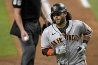 San Francisco Giants' Brandon Crawford turns to the dugout after scoring on his solo home run during the sixth inning of a baseball game against the Texas Rangers in Arlington, Texas, Tuesday, June 8, 2021. (AP Photo/Tony Gutierrez)