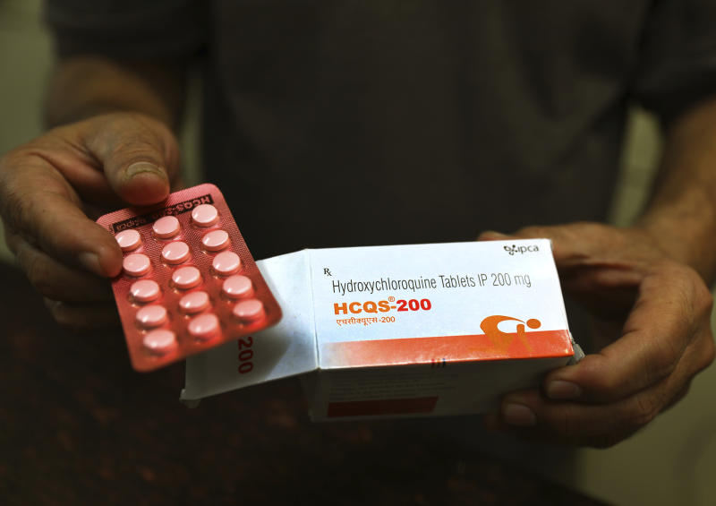 A chemist displays hydroxychloroquine tablets in New Delhi, India, Thursday, April 9, 2020. (AP Photo/Manish Swarup)