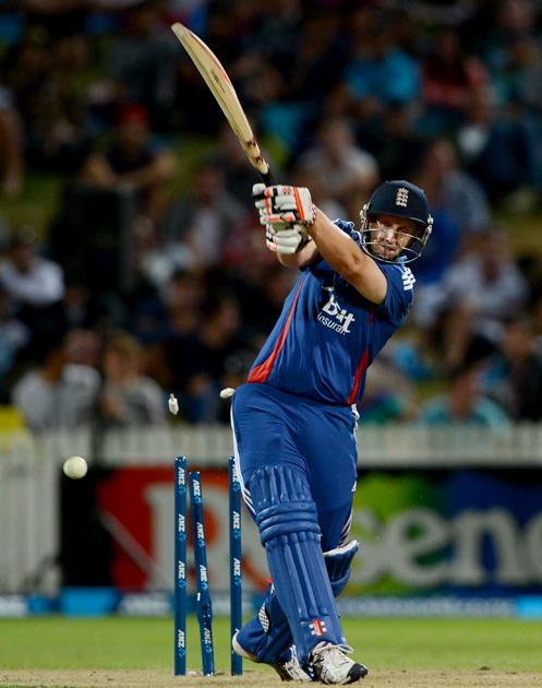 HAMILTON, NEW ZEALAND - FEBRUARY 12:  James Tredwell of England is bowled by James Franklin of New Zealand during the international Twenty20 match between New Zealand and England at Seddon Park on February 12, 2013 in Hamilton, New Zealand.  (Photo by Gareth Copley/Getty Images)