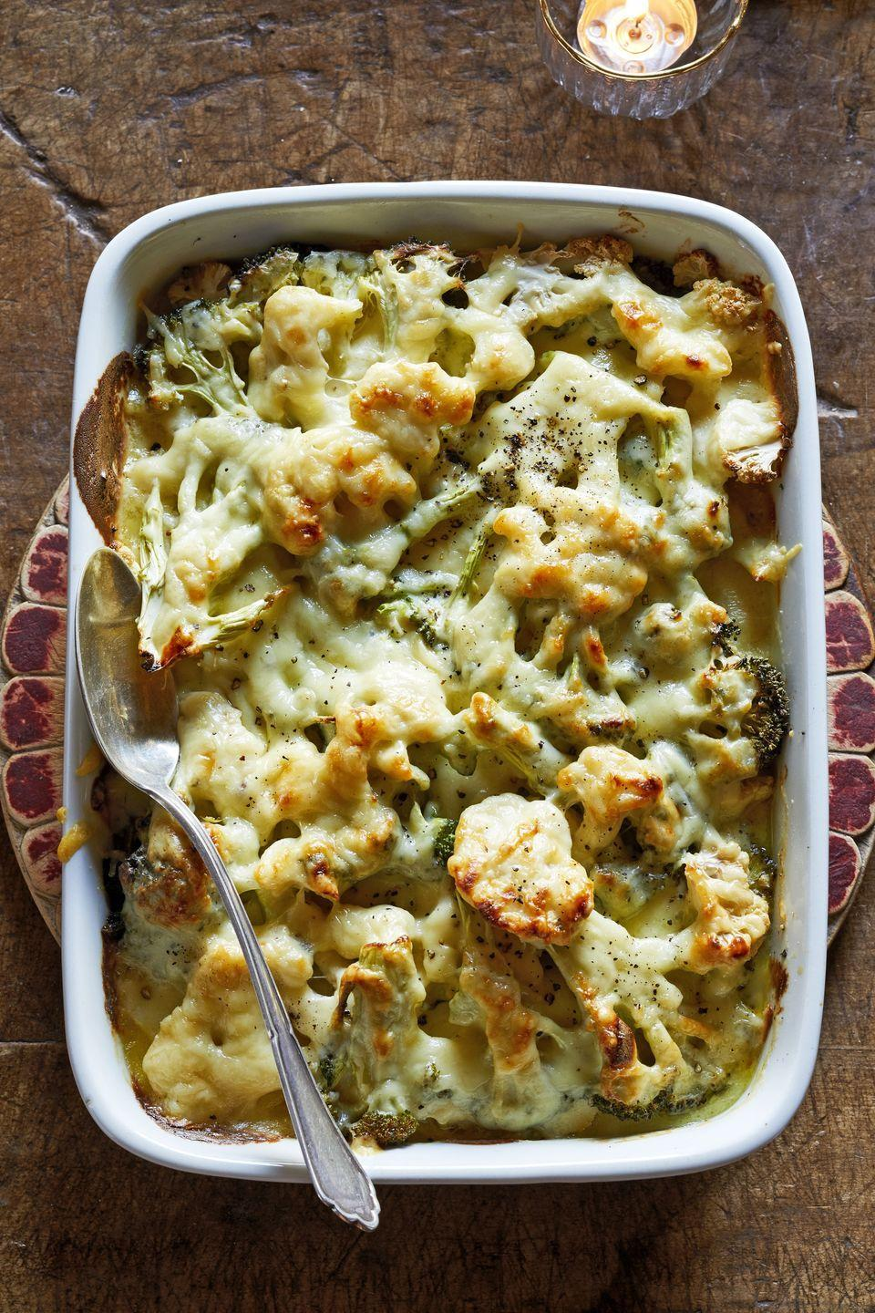 "<p>As far as side dishes go, it will be hard to pass up this broccoli and cauliflower recipe. Even your children won't be able to resist vegetables covered in cheese.</p><p><strong><a href=""https://www.countryliving.com/food-drinks/a29134443/broccoli-and-cauliflower-gratin/"" rel=""nofollow noopener"" target=""_blank"" data-ylk=""slk:Get the recipe"" class=""link rapid-noclick-resp"">Get the recipe</a>.</strong></p><p><strong><a class=""link rapid-noclick-resp"" href=""https://www.amazon.com/dp/B074Z5X8MT/?tag=syn-yahoo-20&ascsubtag=%5Bartid%7C10050.g.896%5Bsrc%7Cyahoo-us"" rel=""nofollow noopener"" target=""_blank"" data-ylk=""slk:SHOP BAKING DISHES"">SHOP BAKING DISHES</a><br></strong></p>"
