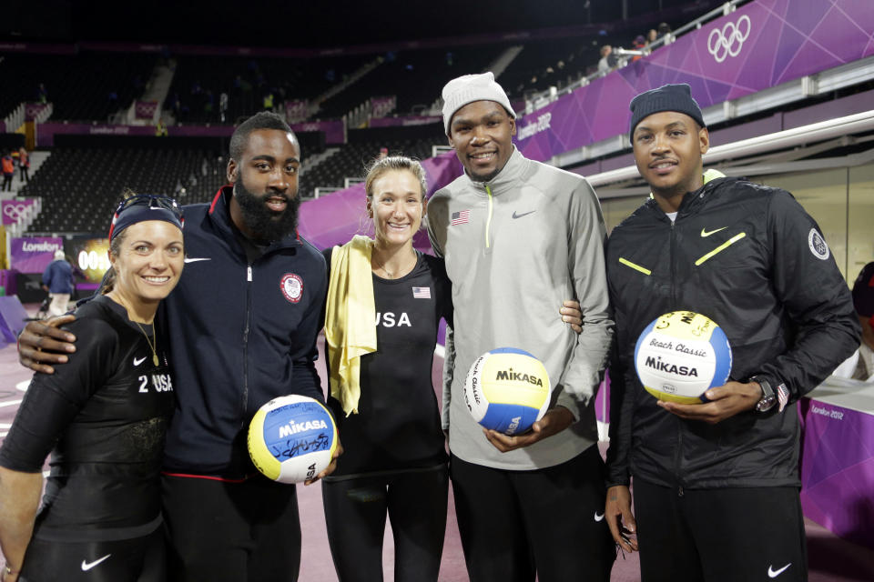 2012 SUMMER OLYMPICS -- Women's Beach Volleyball: US vs. Austria -- Pictured: (l-r) Misty Mae-Treanor, Tyson Chandler, Kerri Walsh-Jennings, Kevin Durant, Carmelo Anthony -- (Photo by: Paul Drinkwater/NBCU Photo Bank/NBCUniversal via Getty Images via Getty Images)