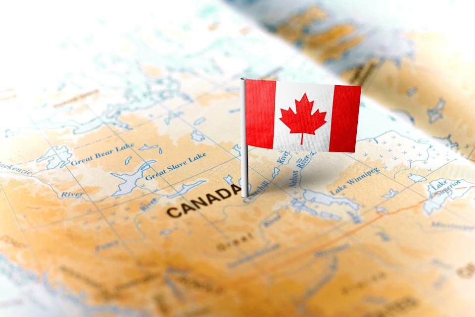 A map of Canada with a flag pinned to it. (Photo: MarkRubens via Getty Images)
