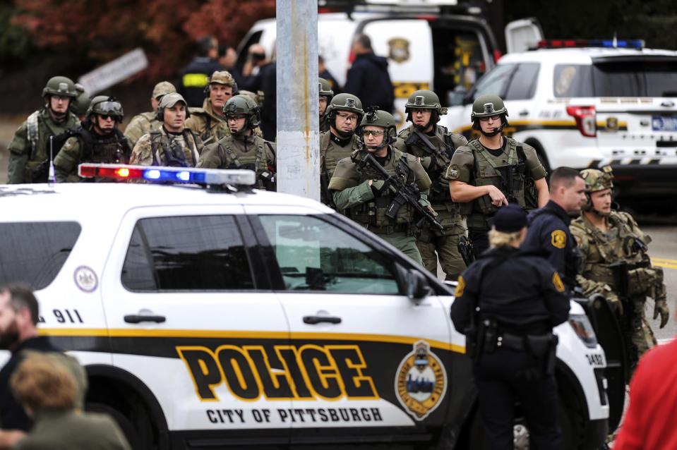 Law enforcement officers at the scene of a shooting at the Tree of Life synagogue in Pittsburgh, Pa., on Saturday. (Photo: Alexandra Wimley/Pittsburgh Post-Gazette via AP)