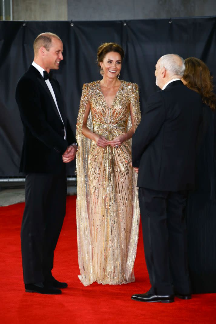 Britain's Prince William, left, and his wife Kate the Duchess of Cambridge are greeted by Barbara Broccoli and Michael G. Wilson upon arrival for the World premiere of the new film from the James Bond franchise, 'No Time To Die', in London Tuesday, Sept. 28, 2021. - Credit: AP