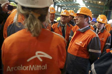 French President Francois Hollande visits the ArcelorMittal steel factory in Florange