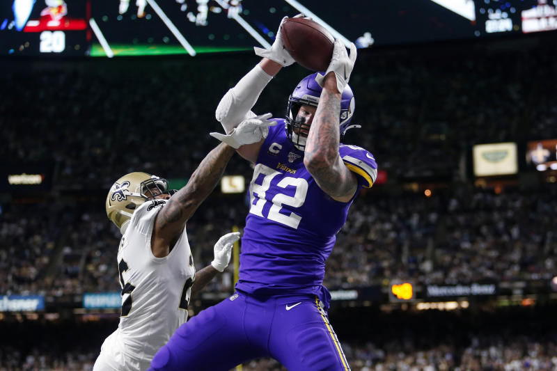 Minnesota Vikings tight end Kyle Rudolph (82) pulls in the game winning touchdown pass over New Orleans Saints cornerback P.J. Williams (26). (AP Photo/Brett Duke)