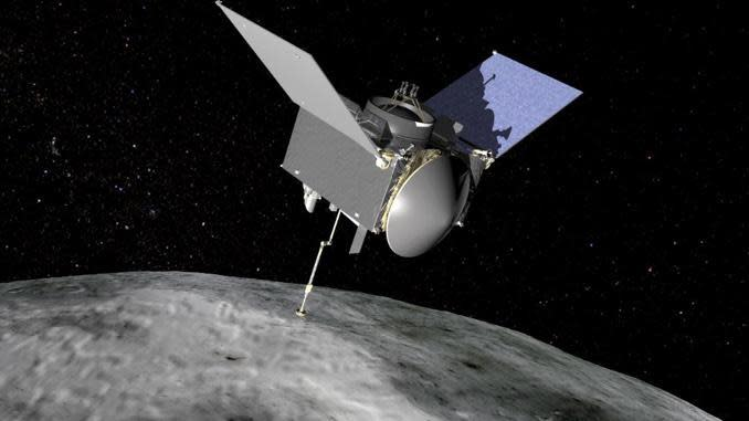 An artist's impression of NASA's OSIRIS-REx spacecraft with its sample collection mechanism extended on the end of the probe's robot arm. Four years after launch from Cape Canaveral, the spacecraft was loaded with updated navigation data early Tuesday for an attempt to collect samples from the surface of rocky asteroid known as Bennu. / Credit: NASA