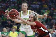 FILE - In this March 8, 2020, file photo, Stanford's Lexie Hull (12), right, grabs the ball around Oregon's Erin Boley, left, during the first half of an NCAA college basketball game in the final of the Pac-12 women's tournament in Las Vegas. Stanford is ranked No. 2 in the women's NCAA college basketball poll released Tuesday, Nov. 10, 2020. (AP Photo/John Locher, File)