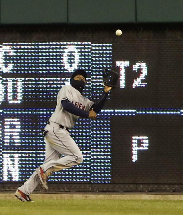Cleveland Indians center fielder Michael Bourn catches the fly hit by Detroit Tigers' Nick Castellanos during the fourth inning of the MLB American League baseball game in Detroit, Wednesday, April 16, 2014. (AP Photo/Carlos Osorio)
