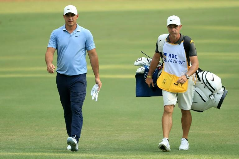 Four-time major winner Brooks Koepka, left, will not play in this week's Travelers Championship after caddie Ricky Elliott, right, tested positive for COVID-19 (AFP Photo/STREETER LECKA)