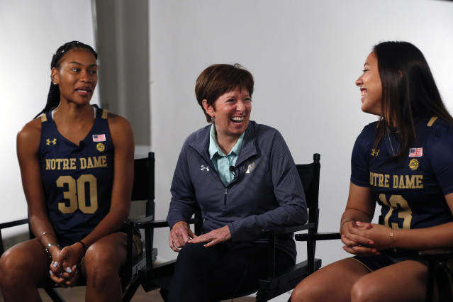 FILE - In this Oct. 3, 2019, file photo, Notre Dame coach Muffet McGraw, center, laughs with players Mikayla Vaughn, left, and Marta Sniezek during the Atlantic Coast Conference women's NCAA college basketball media day in Charlotte, N.C. McGraw faces a big rebuilding project after two runs to the NCAA championship game, including a win two seasons ago. (AP Photo/Nell Redmond, File)