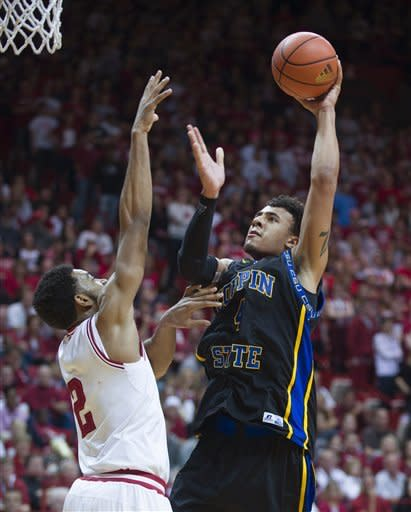 Coppin State's Zach Burnham puts up a shot over Indiana's Christian Watford during the first half of an NCAA college basketball game Saturday, Dec. 1, 2012, in Bloomington, Ind. (AP Photo/Doug McSchooler)