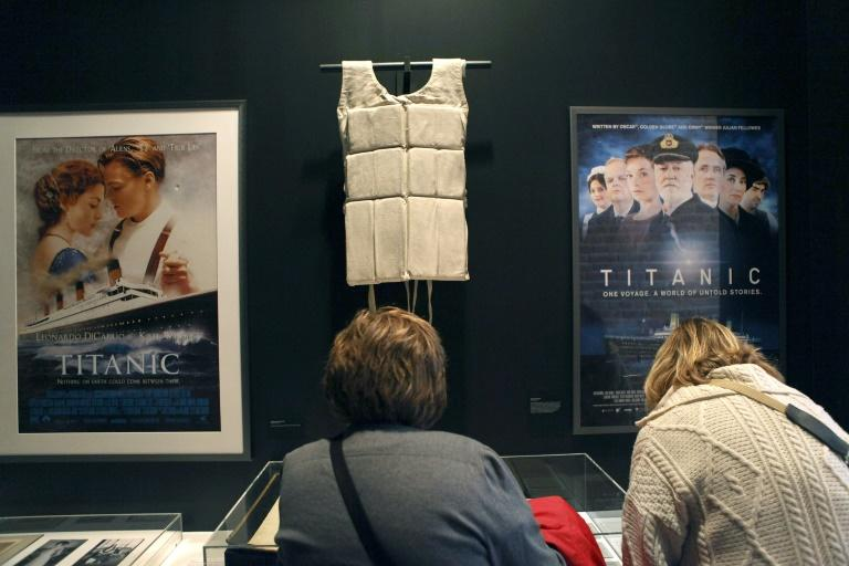 """A life vest and posters from the 1997 movie """"Titanic"""" were featured in a 2012 exhibit, """"Titanic at 100: Myth and Memory"""" in New York"""