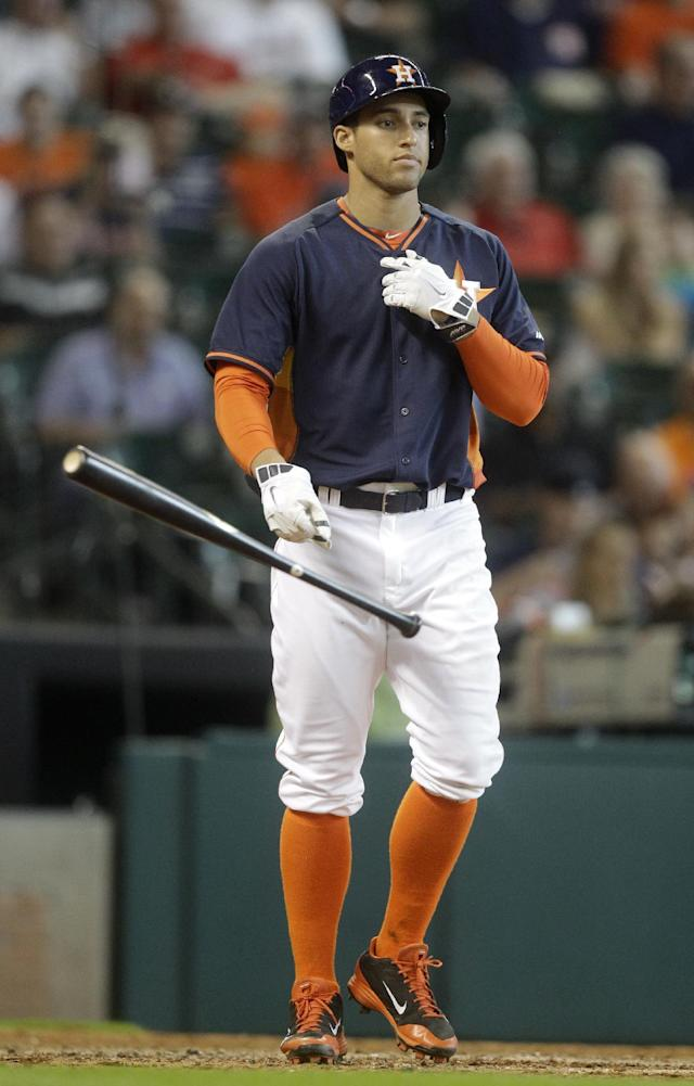 Houston Astros' George Springer tosses his bat after striking out during the seventh inning of a baseball game against the Baltimore Orioles, Sunday, June 1, 2014, in Houston. (AP Photo/Patric Schneider)
