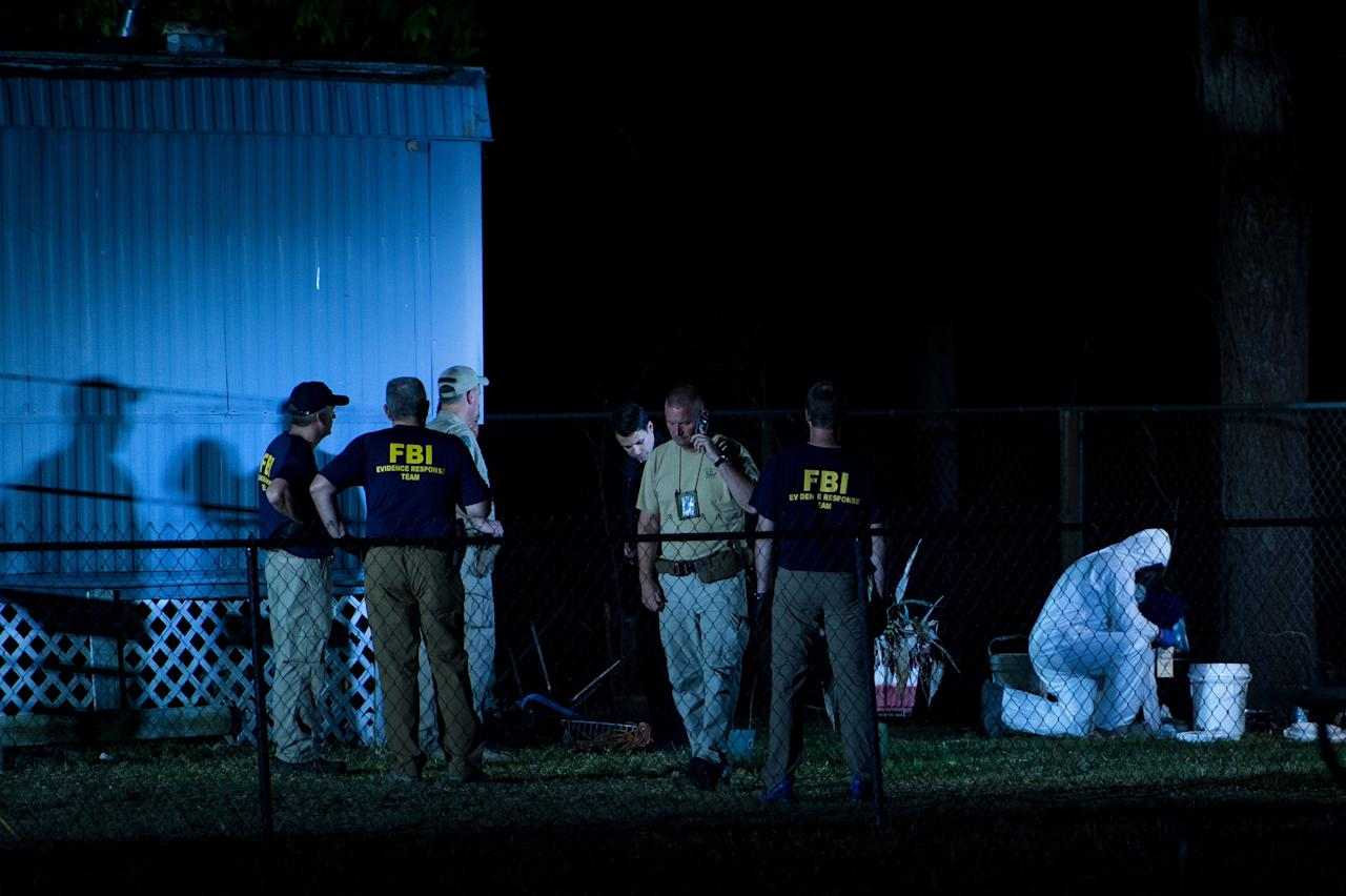 <p>Investigators work outside a trailer near Santa Fe High School following a mass shooting May 18, 2018 in Santa Fe, Texas. (Photo: Brendan Smialowski/AFP/Getty Images) </p>