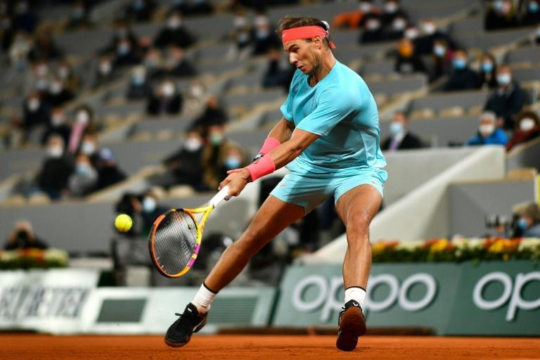 Racquet man: Rafael Nadal on his way to victory over Novak Djokovic in last year's French Open final