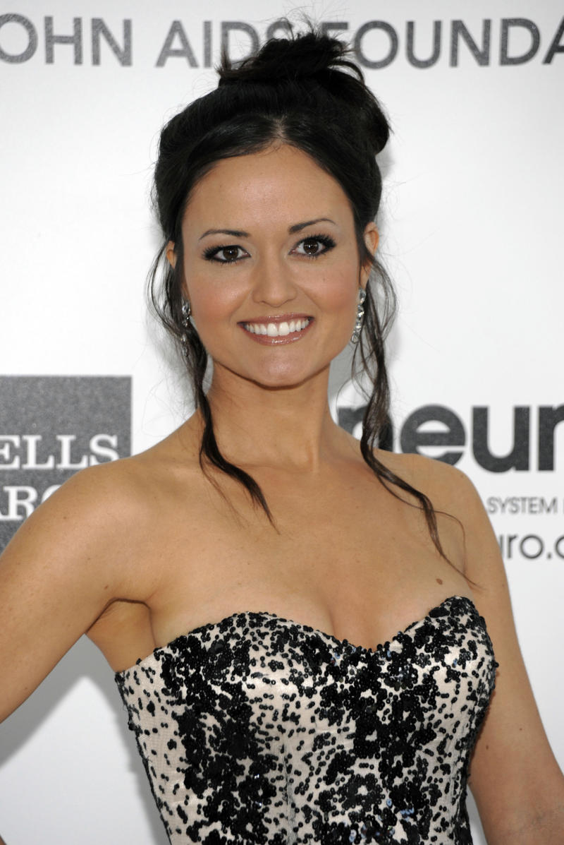 """FILE - In this Sun., Feb. 26, 2012 file photo, actress Danica McKellar arrives at the Elton John AIDS Foundation Academy Awards viewing party in West Hollywood, Calif. McKellar, who starred in the ABC series """"The Wonder Years,""""filed to end her three-year marriage to composer Michael Verta on Monday, June 4, 2012 in Los Angeles.(AP Photo/Dan Steinberg, File)"""