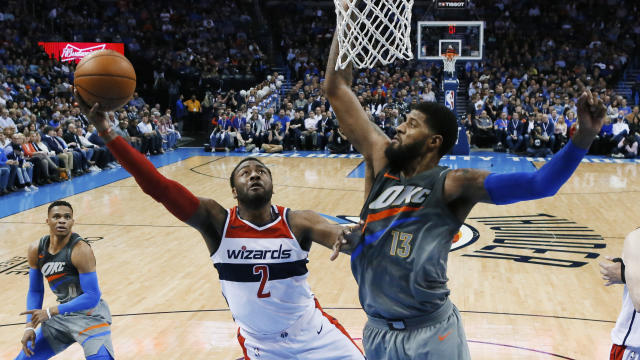 "<a class=""link rapid-noclick-resp"" href=""/nba/players/4716/"" data-ylk=""slk:John Wall"">John Wall</a> and <a class=""link rapid-noclick-resp"" href=""/nba/players/3983/"" data-ylk=""slk:Marcin Gortat"">Marcin Gortat</a> won't be each other's Valentines, but that's OK. (AP Foto/Sue Ogrocki)"