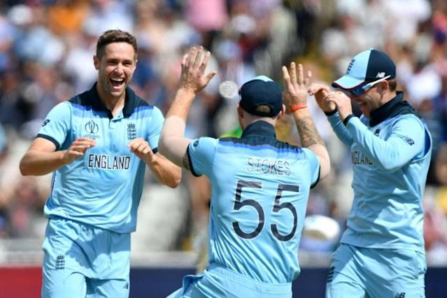 England's Chris Woakes (left) celebrates his dismissal of Australia's Peter Handscomb in the World Cup semi-final at Edgbaston (AFP Photo/Paul ELLIS)