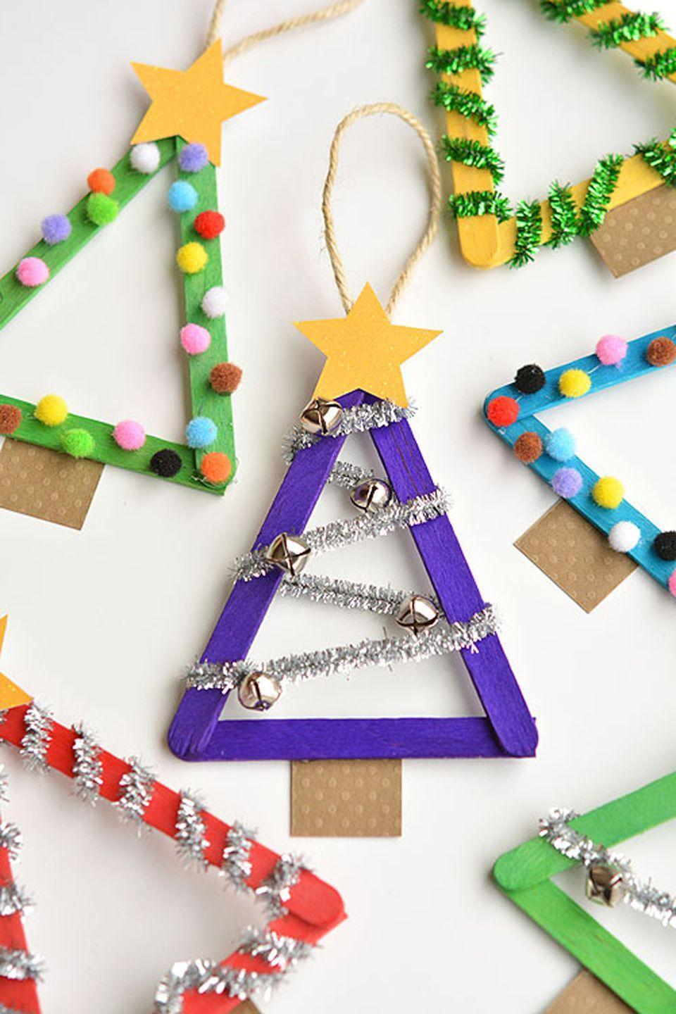 "<p><span class=""redactor-invisible-space"">Decorating these popsicle stick ornaments will be a special treat <span class=""redactor-invisible-space"">for your little helper.</span></span></p><p><strong>Get the tutorial at <a href=""http://onelittleproject.com/popsicle-stick-christmas-trees/"" rel=""nofollow noopener"" target=""_blank"" data-ylk=""slk:One Little Project"" class=""link rapid-noclick-resp"">One Little Project</a>.</strong></p>"