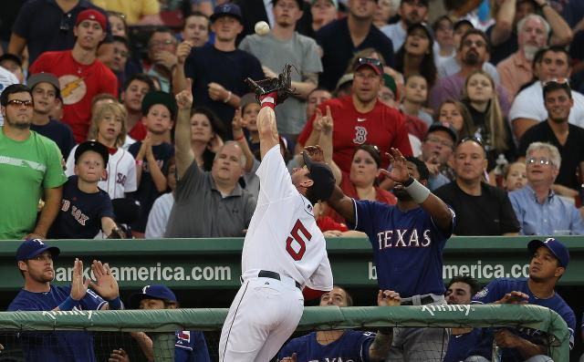 BOSTON, MA - AUGUST 7: Nick Punto #5 of the Boston Red Sox makes a catch on a foul ball against the Texas Rangers at Fenway Park August 7, 2012 in Boston, Massachusetts. (Photo by Jim Rogash/Getty Images)