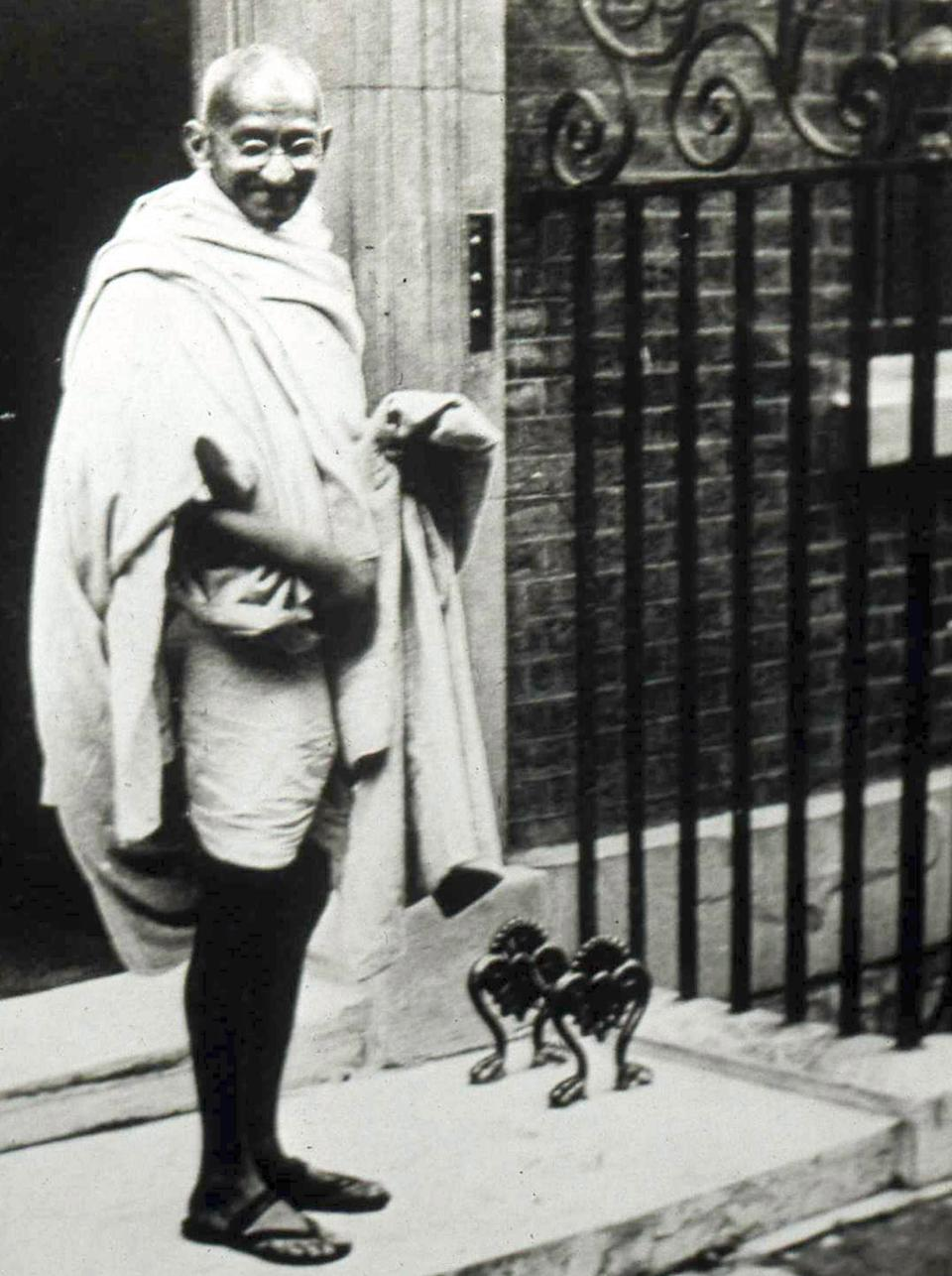 Mahatma K Gandhi (1869-1948) visited Britain in 1931 to attend the second Round Table conference. He visited the British Prime Minister, Ramsay MacDonald, at 10 Downing Street. (Photo by Universal History Archive/Getty Images)