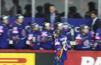 Mike Hammond of Britain, celebrates scoring a goal during the Ice Hockey World Championship group A match between Britain and Denmark at the Olympic Sports Center in Riga, Latvia, Tuesday May 25, 2021. (AP Photo/Roman Koksarov)