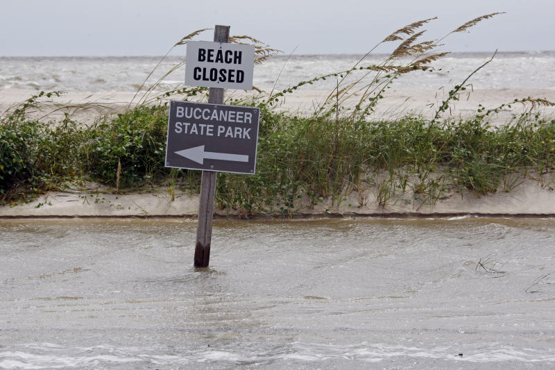 High tide and rising waves forced the closing of Buccanneer State Park and Beach Boulevard in Waveland, Miss., as Isaac's winds and rain hit the Mississippi Gulf Coast, Tuesday, Aug. 28, 2012. The U.S. National Hurricane Center in Miami said Isaac became a Category 1 hurricane Tuesday with winds of 75 mph. It could get stronger by the time it's expected to reach the swampy coast of southeast Louisiana. (AP Photo/Rogelio V. Solis)