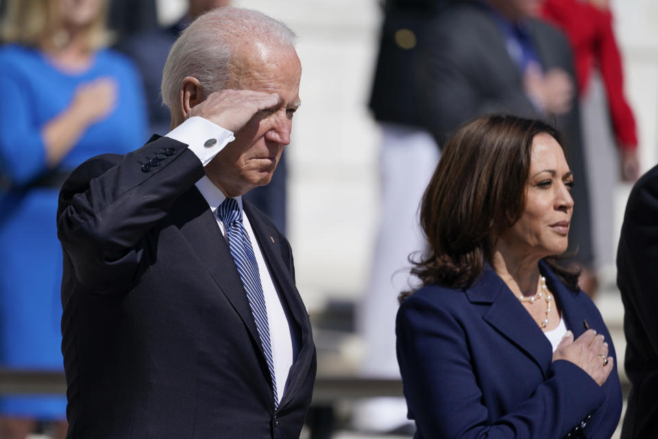President Joe Biden and Vice President Kamala Harris stand at attention after placing a wreath at the Tomb of the Unknown Soldier at Arlington National Cemetery on Memorial Day, Monday, May 31, 2021, in Arlington, Va.(AP Photo/Alex Brandon)