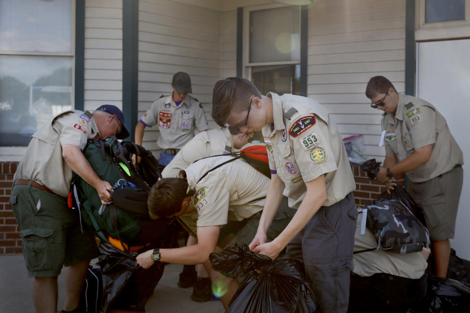 Boy Scouts with a Downs, Ill., troop prepare their luggage before boarding a westbound Amtrak train for a 14-day camping trip in New Mexico, Tuesday, June 15, 2021, Galesburg, Ill, (AP Photo/Shafkat Anowar)