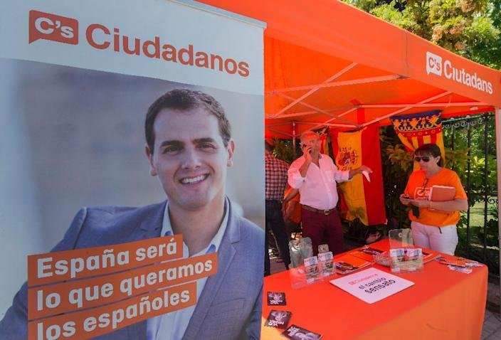 """Two new electoral contenders have harnessed the popular unrest of the """"Indignado"""" movement: centrist party Ciudadanos and left-wing Podemos (AFP Photo/Jose Jordan)"""