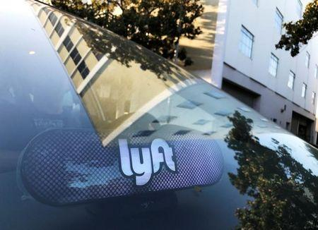 FILE PHOTO:    An illuminated sign appears in a Lyft ride-hailing car in Los Angeles