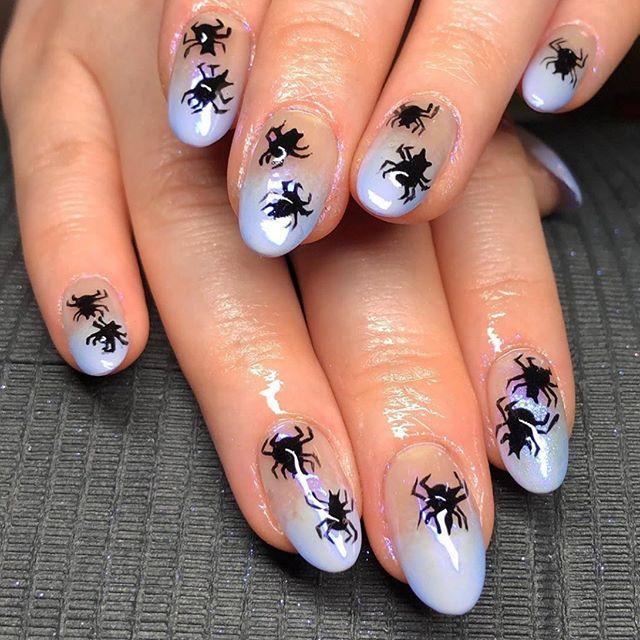 "<p>Not only are these light-purple tips beyond pretty, but the medium-sized spiders are the perfect Halloween art touch. </p><p><a href=""https://www.instagram.com/p/B7ruXO0HcjZ/?utm_source=ig_embed&utm_campaign=loading"" rel=""nofollow noopener"" target=""_blank"" data-ylk=""slk:See the original post on Instagram"" class=""link rapid-noclick-resp"">See the original post on Instagram</a></p>"