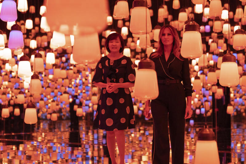 U.S. first lady Melania Trump, right, and Japanese Prime Minister Shinzo Abe's wife Akie Abe visit a digital art museum in Tokyo Sunday, May 26, 2019. (Pierre-Emmanuel Deletree/Pool Photo via AP)