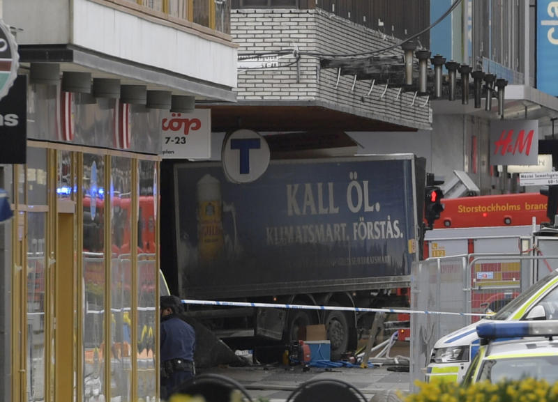 <p> The rear of a truck, left, protrudes after it crashed into a department store injuring several people in central Stockholm, Sweden, Friday April 7, 2017. (Anders Wiklund , TT News Agency via AP) </p>