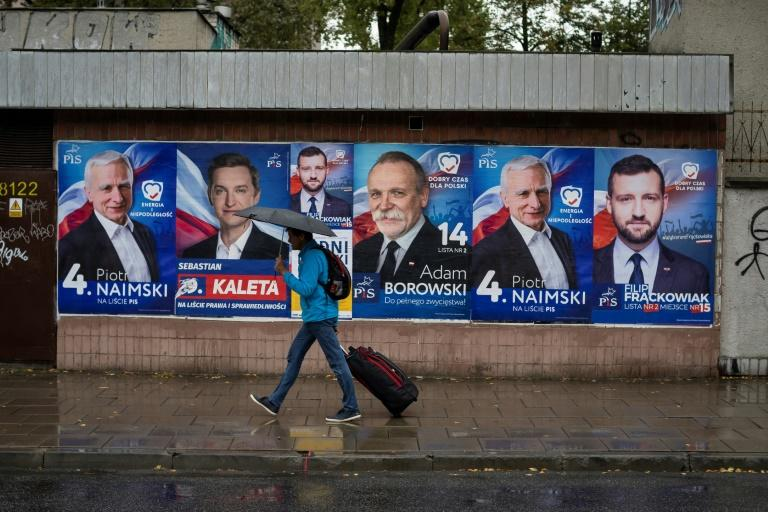 The election followed a campaign focused on a raft of new welfare measures coupled with attacks on LGBT rights and Western values (AFP Photo/Wojtek RADWANSKI)