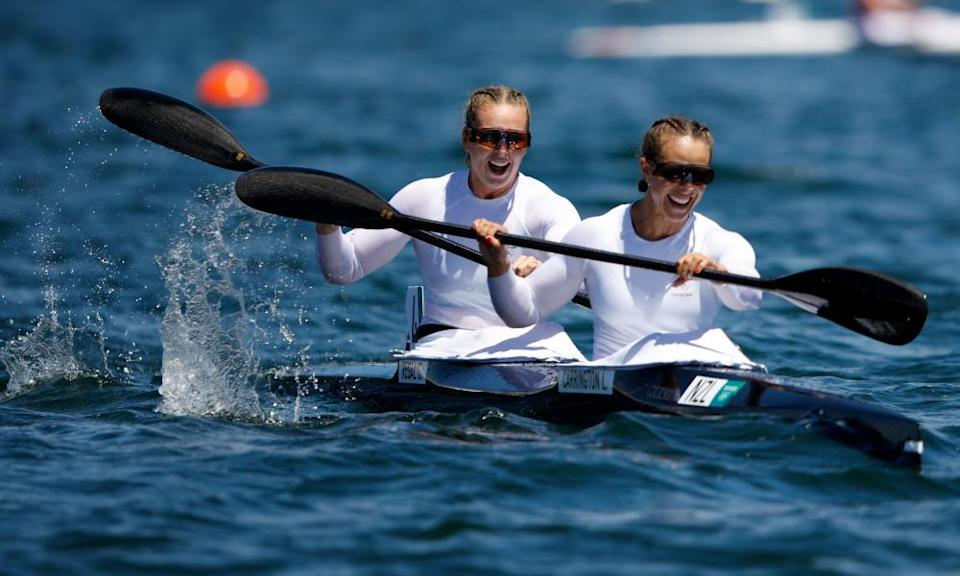 Lisa Carrington and Caitlin Regal celebrate at the end of the gold medal race.