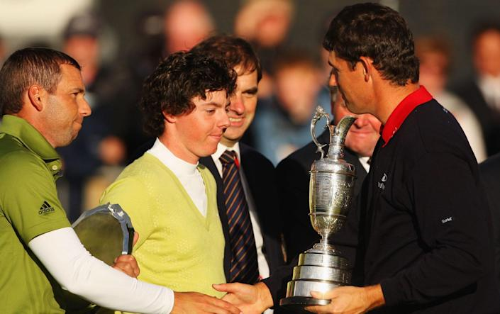 Padraig Harrington shakes hands with Sergio Garcia during the presentation of the Claret Jug in 2007. - GETTY IMAGES