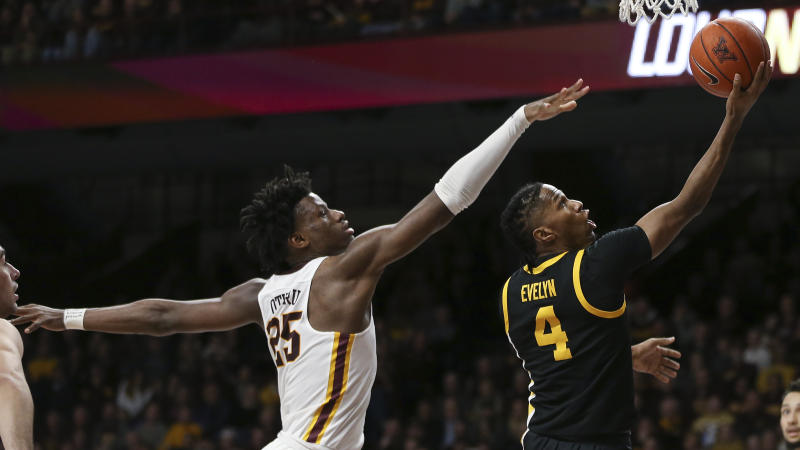 Iowa's Bakari Evelyn goes up to the basket past Minnesota's Daniel Oturu during the second half of an NCAA college basketball game Sunday, Feb. 16, 2020, in Minneapolis. Iowa won 58-55. (AP Photo/Stacy Bengs)
