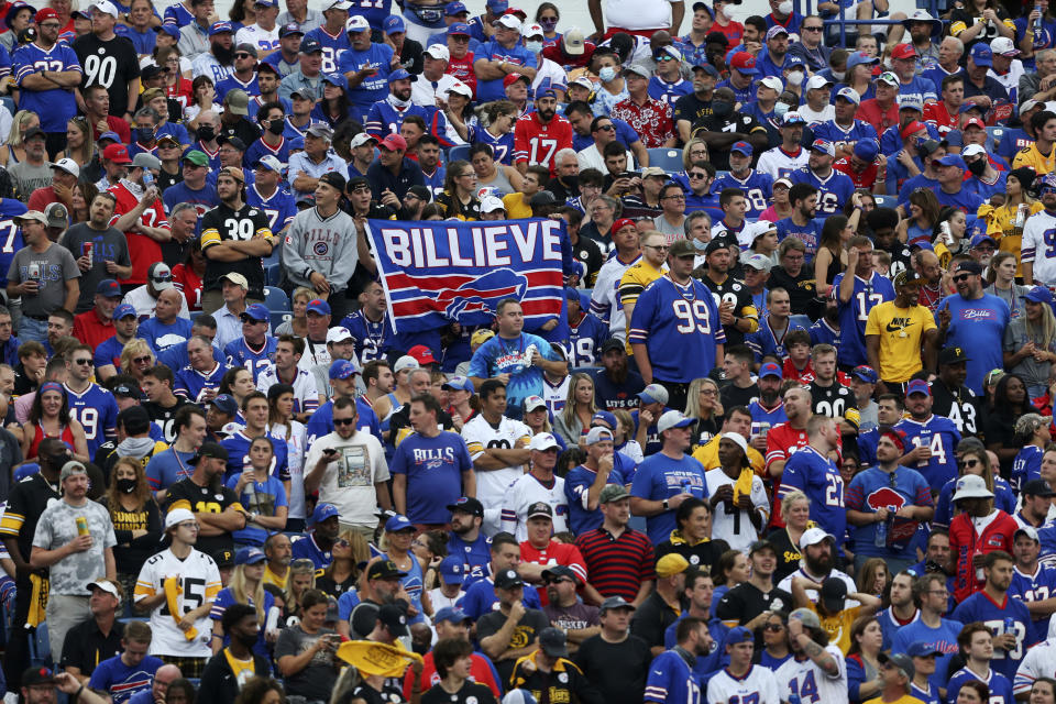 Fans watch the second half of an NFL football game between the Buffalo Bills and the Pittsburgh Steelers in Orchard Park, N.Y., Sunday, Sept. 12, 2021. (AP Photo/Joshua Bessex)