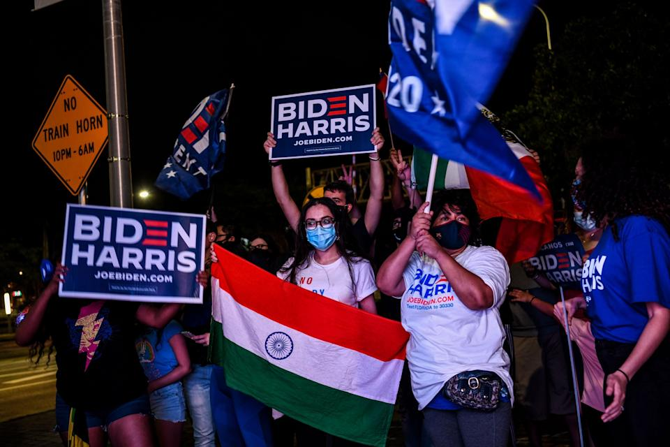 A supporter holds a national flag of India at a watch party in Miami as President-elect Joe Biden and Vice President-elect Kamala Harris deliver victory remarks on Nov. 7, 2020. (Photo: CHANDAN KHANNA/AFP via Getty Images)